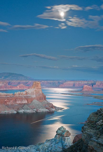 Lake Powell AZ - 2,000 miles of coastline, secluded sandy coves.  I want to rent a houseboat and spend a week here.