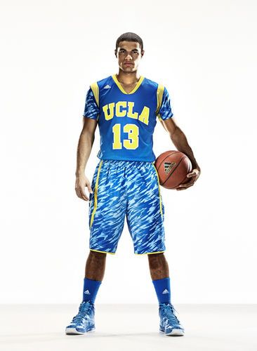 UCLA's new jersey is blue with yellow lettering and striping around the neck and on the shoulders. The sleeves of the jersey and the Bruins' matching shorts feature a camouflage print in several shades of blue.