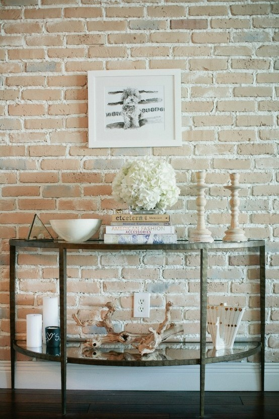 exposed brick entry way glass table
