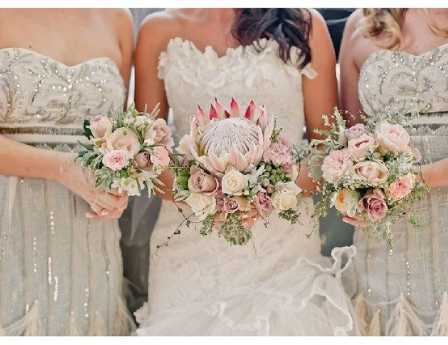 Sweet Violet Bride - http://sweetvioletbride.com/2013/02/wedding-flower-inspiration-protea/
