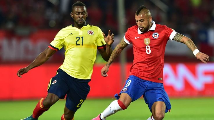 Chile's Arturo Vidal tries to get away from Colombia's Jackson Martinez
