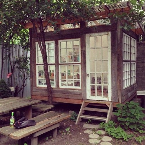 A backyard painting studio in Williamsburg. (this is a good idea: a small shed with windows and french doors for walls to let in light)