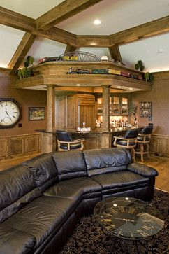 John Kraemer & Sons ~  home bar with custom train track above.