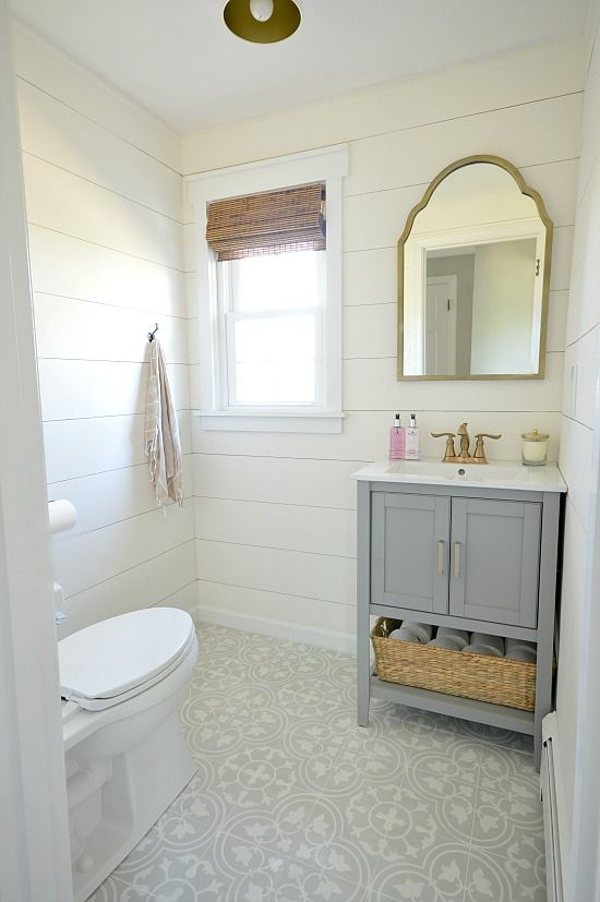 First Floor Bathroom Powder Room Renovation That Includes Gray And Gold Tones Shiplap