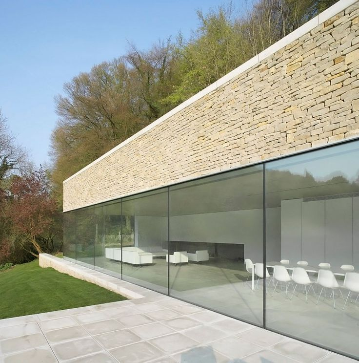 Private Houseis a vacation home located in a scenic and secluded part of England known as Cotswolds.Designed by London based architecture firmFound Associates,the houseis an extension of an 18th century stone cottage. The structure extends from both ends of the old cottage but doesn't fully envelope it.This design allows both the cottage and extension to feel like unique volumes living in harmony. Private House also sits harmoniously with the surrounding landscape:the large structure…