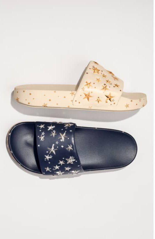 3be7cbd23 Star studs and patterning twinkle on a leather slide sandal that s molded  to comfortably cradle the foot.