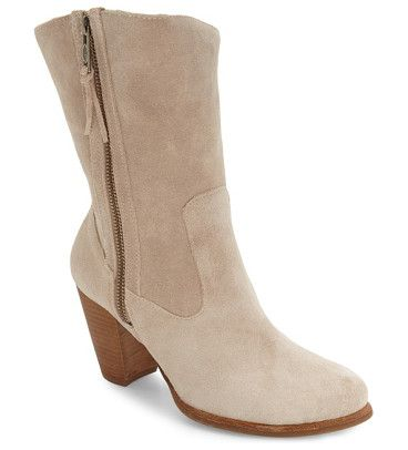 Ugg lynda block heel boot by UGGR. Minimalist styling and a sleek block heel modernize a casual Western-inspired boot lined with plush genuine shearling.