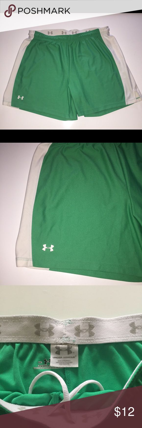 """Under Armour Athletic green shorts M loose fit Womens Under Armour Athletic Shorts  Fit: Loose  Color: Green and White  Size: Medium  5"""" inseam  elastic waist with drawstring  14"""" length  Nice clean condition, no flaws  Non smoking home Under Armour Shorts"""