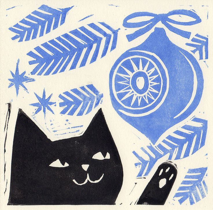 Black cat lino print christmas card. Pooka playing with a bauble by Matt Johnson.