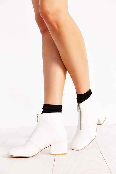 Details  Product Sku: 33375965; Color Code: 010  Square-toed patent leather boots with side zip detailing, from Cheap Monday. Feature a cushioned footbed, a chunky rubber heel, and finished with a textured rubber sole.  At urban Outifitters( US exclusively)