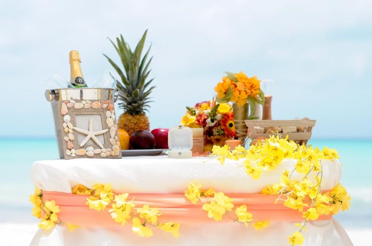 Wedding reception decorations in yellow-appricot colors. Renewal of vow in Dominican Republic.