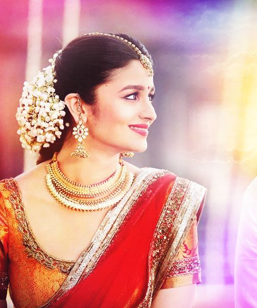 """ ❝…Ananya sat in a gorgeous nine-yard dark silk sari. She wore diamond and gold necklaces. She looked like an accessible goddess.❞ - Krish Malhotra """