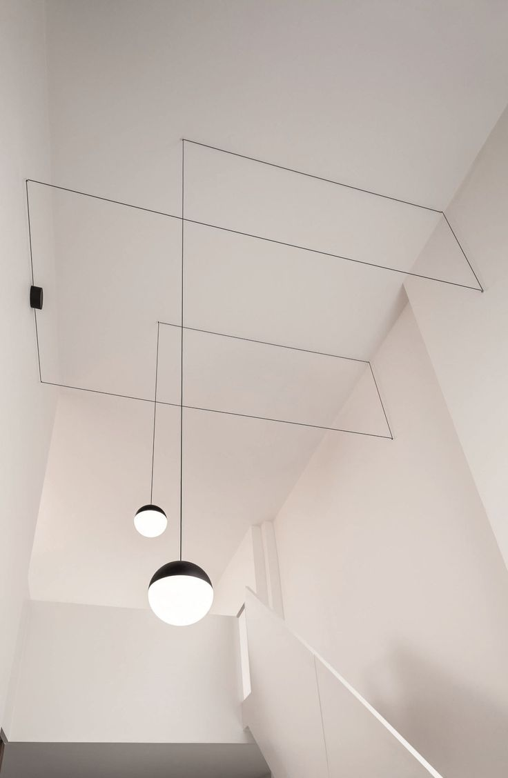 """String Lights by Flos Nederland  """"a black electric wire that sets up a relationship with the architecture of a space, precisely becoming part of the lines formed by the walls of a room."""""""