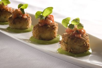 My husband is a cook at Wolfgang Puck Bar and Grill and he makes these delicious sautéed maine crab cakes with basil aioli