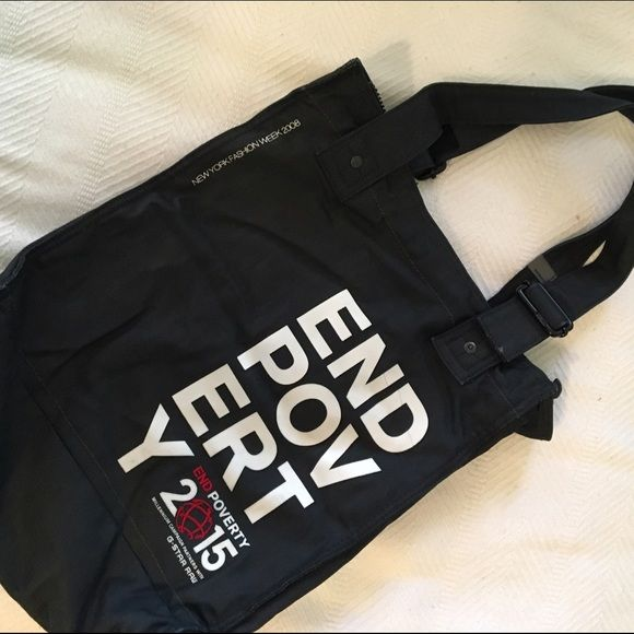- G-STAR TOTE BAG. G-STAR RAW TOTE BAG. Used a couple of times. Slight cracking on letters, see pic4. Very cool bag made of g-star denim. Fully zips on  top,inside zipper pocket too  and a phone pocket. Has little feet at the bottom too. G-Star Bags Totes