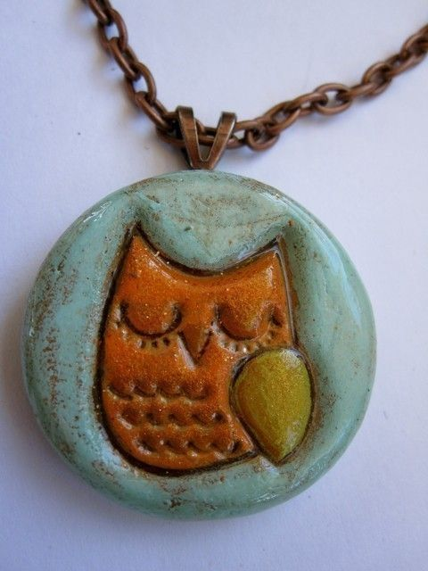 sweet little sleepy owl getting ready for the fall!!    This cute necklace was hand manipulated and painted and then antiqued by me. I then varnish