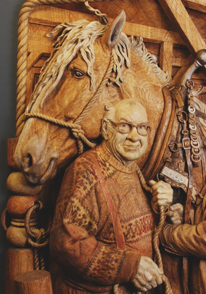 "Fred Cogelow - ""Greatest Generation/Beta Team/November"" - 2015 ArtPrize,  Grand Rapids Michigan ~ Portrait of a fine Belgian equine and two friends. Based on combined/altered photo compositions with concocted background and hame. Carved in butternut. A ""high-mezzo"" relief, carved from a 4"" base slab with laminations to right arm and part of the gate employed as a framing element at bottom. This proved the most laborious enterprise of my career, far more demanding than pieces ........"