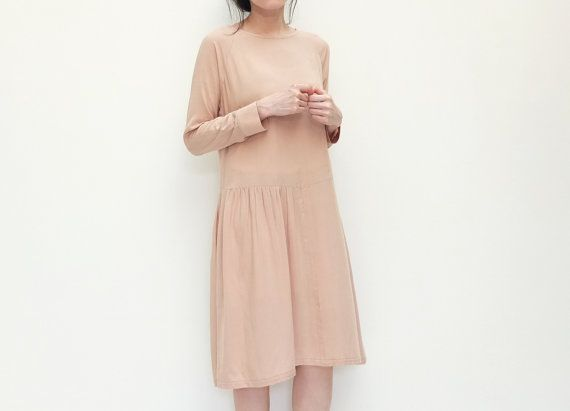 Neutral beige dress with basque waist design and by Metaformose