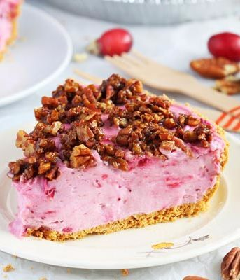 No Bake Cranberry Cheesecake Pie-Take the classic cranberry pie to the next level and WOW your guests with this easy to make No Bake Cranberry Cheesecake Pie with sugared pecans on top. Smooth and creamy with just the right amount of crunch.: