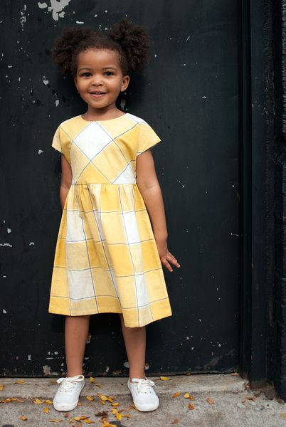 A beautiful dress in bold sunny plaid that will quickly become a closet favourite. The fabric is a hardy handwoven cotton khadi that becomes softer with every wash. It is lined at chest and has a butt