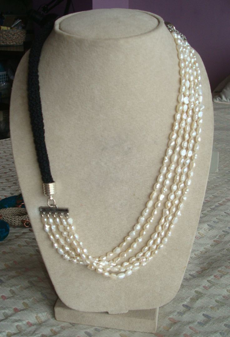 Handcrocheted collar and fresh water pearls.