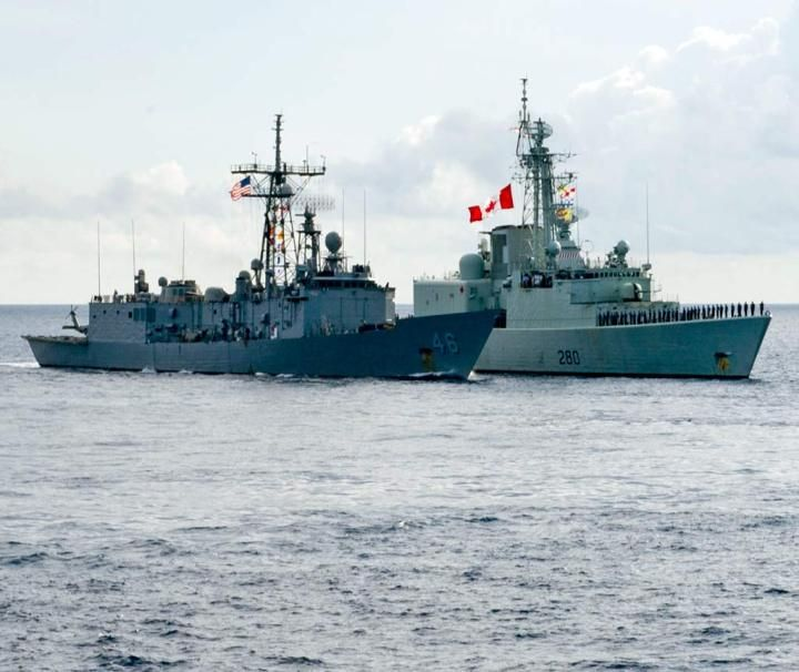 The guided-missile frigate USS Rentz (FFG 46), left, and the Royal Canadian Navy frigate HMCS Iroquois (F 280) transit the Caribbean Sea during the UNITAS 2013 multinational maritime exercise hosted this year by the Colombian Navy. U.S. participation in UNITAS 2013 was scaled down as a result of sequestration. Royal Canadian Navy photo by Cpl. Anthony Chand