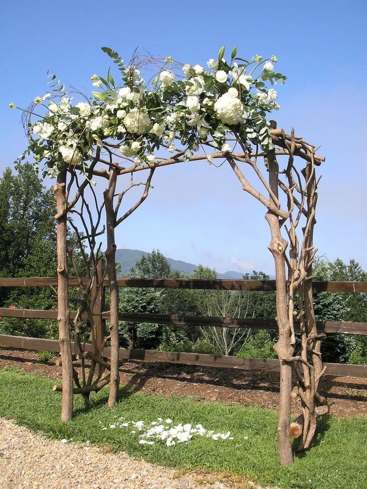 this for beach pergola using driftwood. Add white draping, florals, and shells. LIke the soft color of the wood
