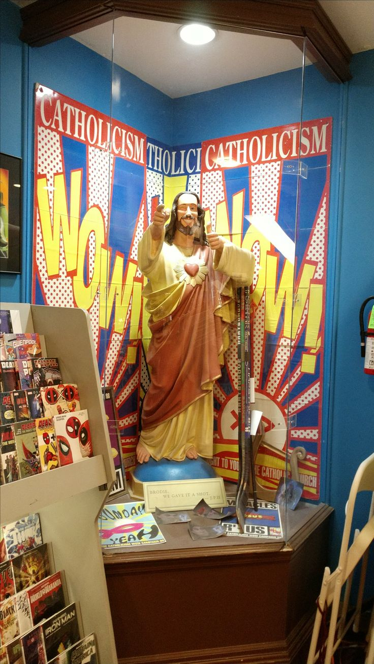 """The """"Buddy Christ"""" statue in Kevin Smith's Jay and Silent Bob's Secret Stash comic book & novelty store in Red Bank, New Jersey. The statue appeared in Dogma and miniature dashboard versions of it are available for sale in the store and online (one such miniature was seen on a car dashboard in Smith's film Jay & Silent Bob Strike Back). The Catholicism Wow signage around the Buddy Christ also appeared in Dogma."""