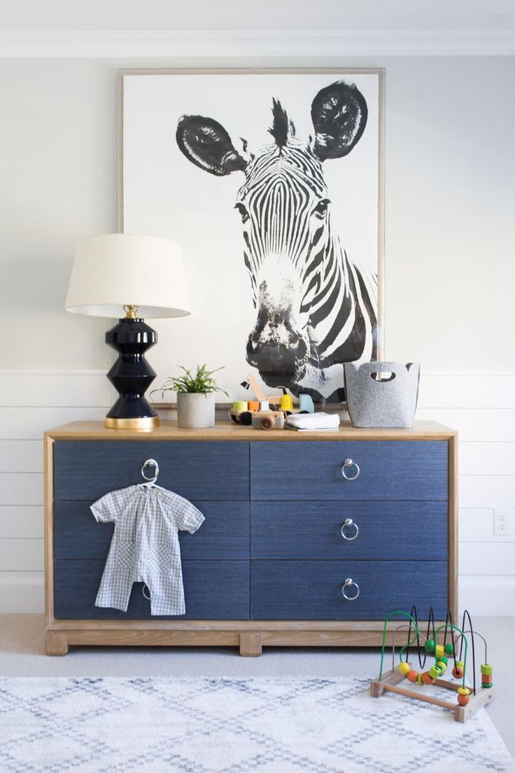 Animal poster and dark tones fills this room with winter vibes | #greywalls #animalpattern #zebra #kidsroom