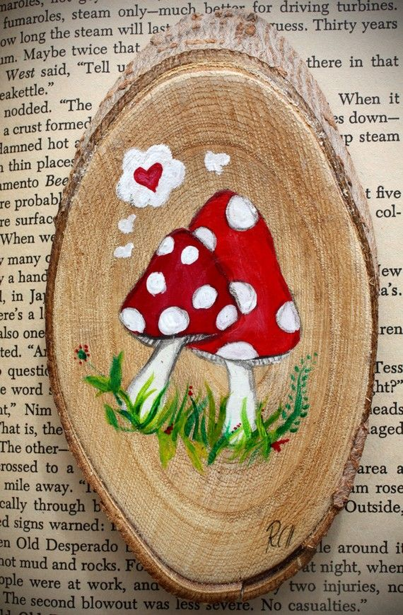 Very DIYable! Mushroom painted on a piece of wood, probably with acrylic paint.