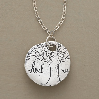 "Jes MaHarry's oak tree amulet with ""heal"" inscribed on the front, ""Be brave and have courage,"" on the back.  Why oh why do love jewelry with words so much?"