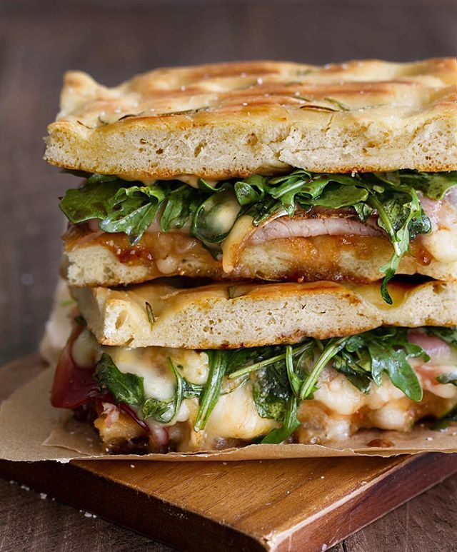 prosciutto, turkey, brie, fig jam, arugula & balsamic pressed sandwich on homemade focaccia