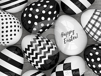 3d Easter eggs with black and white patterns lying on wooden desk