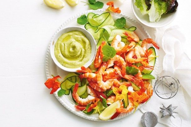 """""""This recipe is a fun take on the classic prawn cocktail. I've given the usual Marie Rose sauce a green twist by using avocado instead of cream or mayonnaise, making it both dairy and egg free. This is one of my summertime faves and is perfect as a shared appetiser or placed in the middle of the table on Christmas Day."""" Georgia Barnes"""