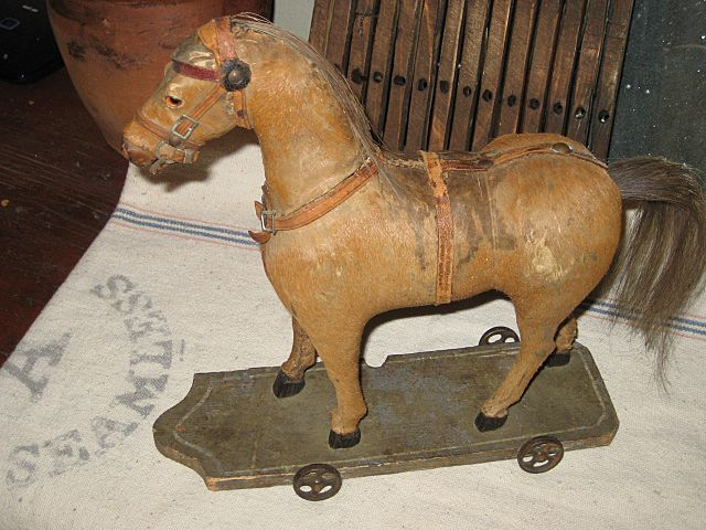 Early Horse on platform/wheels...................