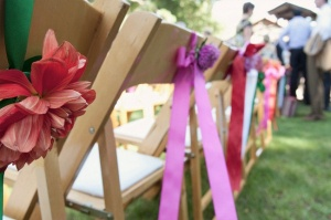 flowers and ribbons on chairs
