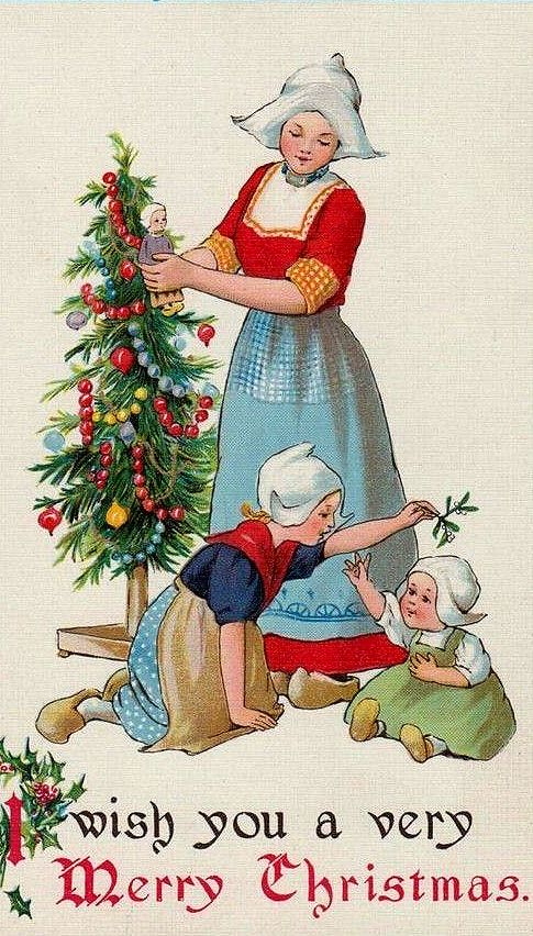 Antique Postcard  .. Holding Mistletoe, over the baby's head. Dutch Children in postcard.