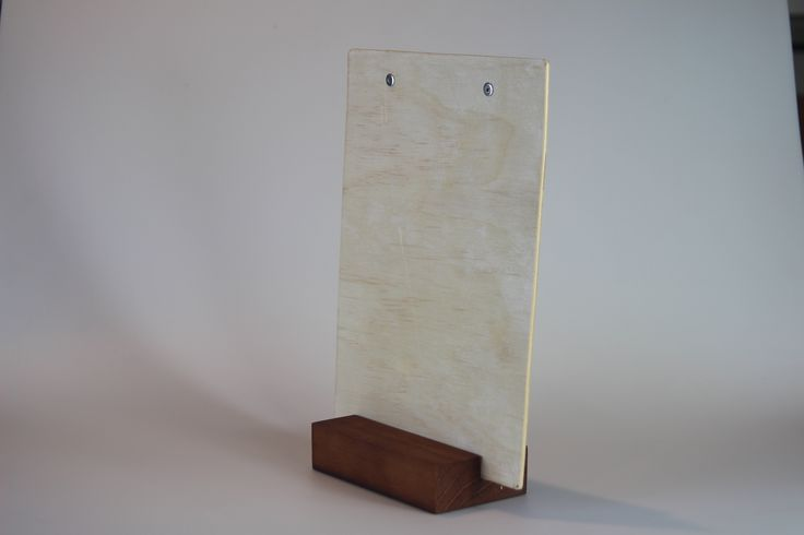 An A4 size white wash timber board standing in our timber block.