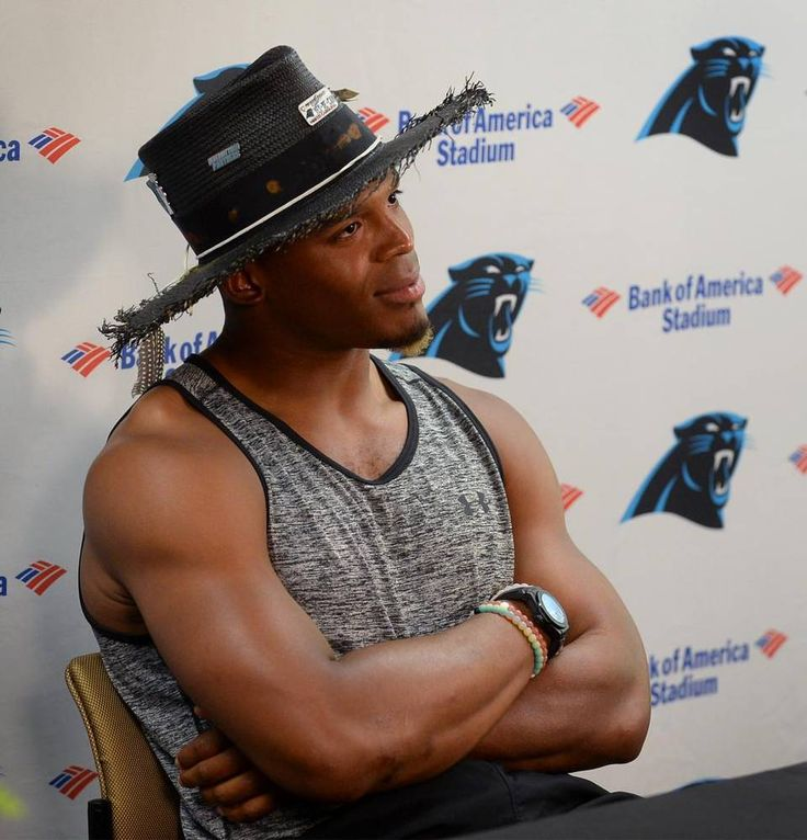 Carolina Panthers quarterback Cam Newton listens to a reporter's question during a press conference at Wofford College in Spartanburg, SC…