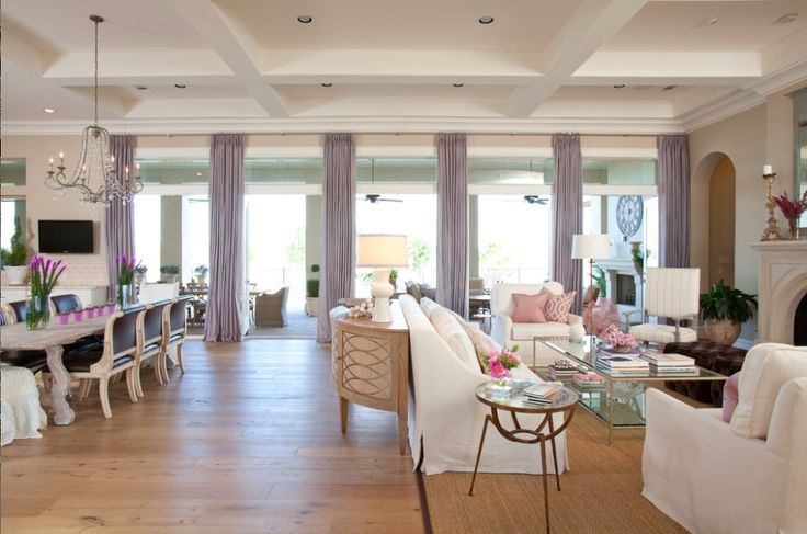 This rustic traditional home carries a continuous flow of design throughout this space. The kitchen, dining area and family room are often joined spaces. Have them relate to one another by carrying the same theme with color and style throughout. Visit www.benjaminrugsandfurniture.com