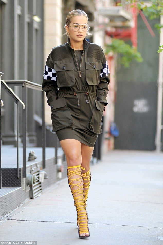 No missing her:She completed her look with a pair of clear sunglasses, yellow eyeshadow and a pair of unusual knee-high Dsquared boots-cum-sandals