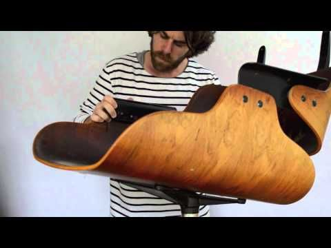 Repair of a 1976 Eames Lounge Chair Model 670 - Rosewood & Black Leather. Shock Mounts had previously been repaired by drilling through rosewood and adding s...