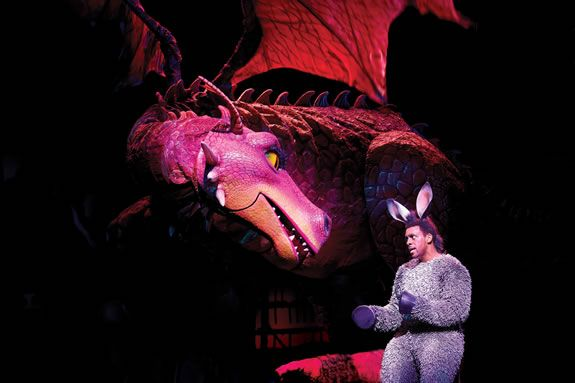 Dragon with Richard Blackwood as Donkey in Shrek The Musical at Theatre Royal Drury Lane. Photo by Brinkhoff Mögenburg