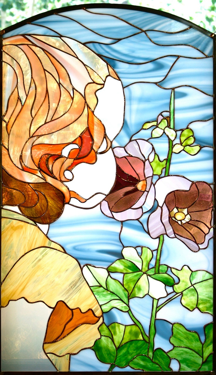 Young Child Smelling Flowers