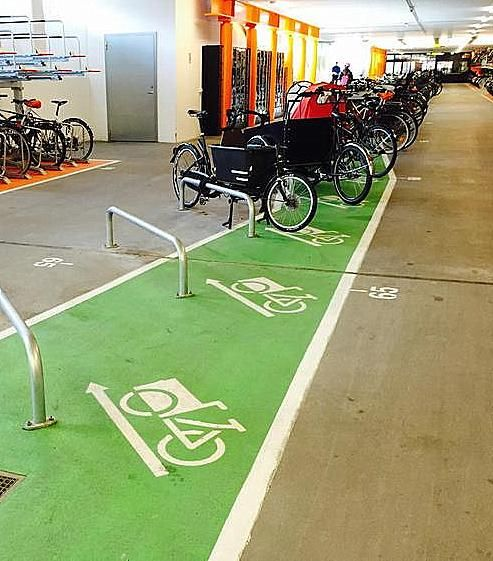 Cargo bike parking at the train station in Malmö, Sweden. Click image to tweet and visit the slowottawa.ca boards >> https://www.pinterest.com/slowottawa/boards