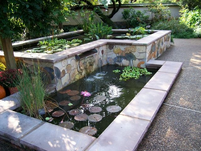 ponds Aquatic plants and mosaics soften the rectolinear design More