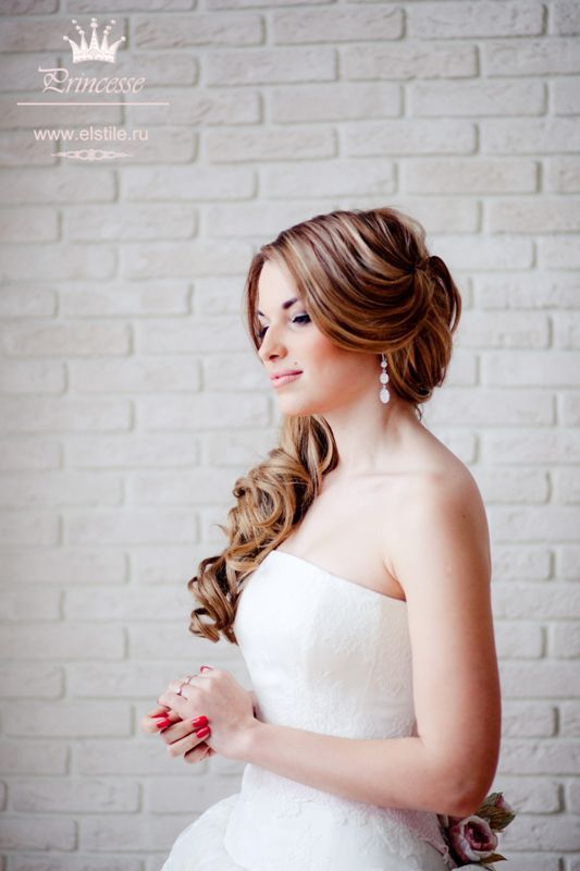 Wedding hairstyles long hair fastened behind stacked on one side