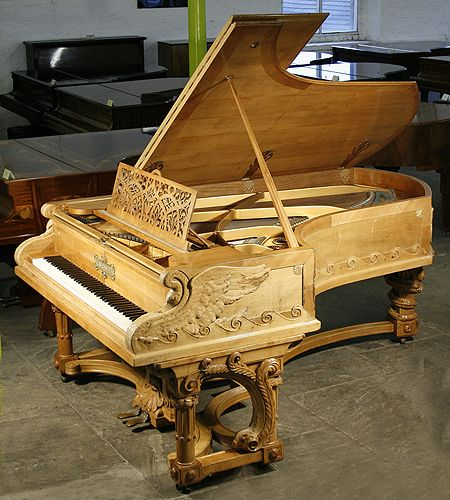 Bechstein Model C Grand Piano For Sale with a Walnut Case. Case Features Carvings of Swans, Serpents and Dragons Inspired by the Nordic Edda Poems.