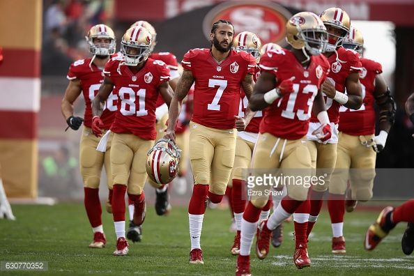 News Photo : Colin Kaepernick of the San Francisco 49ers runs...