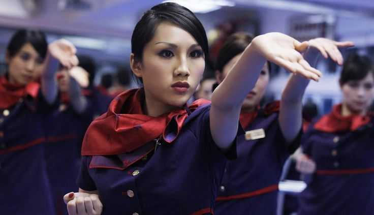 HK airlines stewardess learning Wing Chun Kungfu  http://www.flickr.com/photos/myfreeco/5905205292/lightbox/